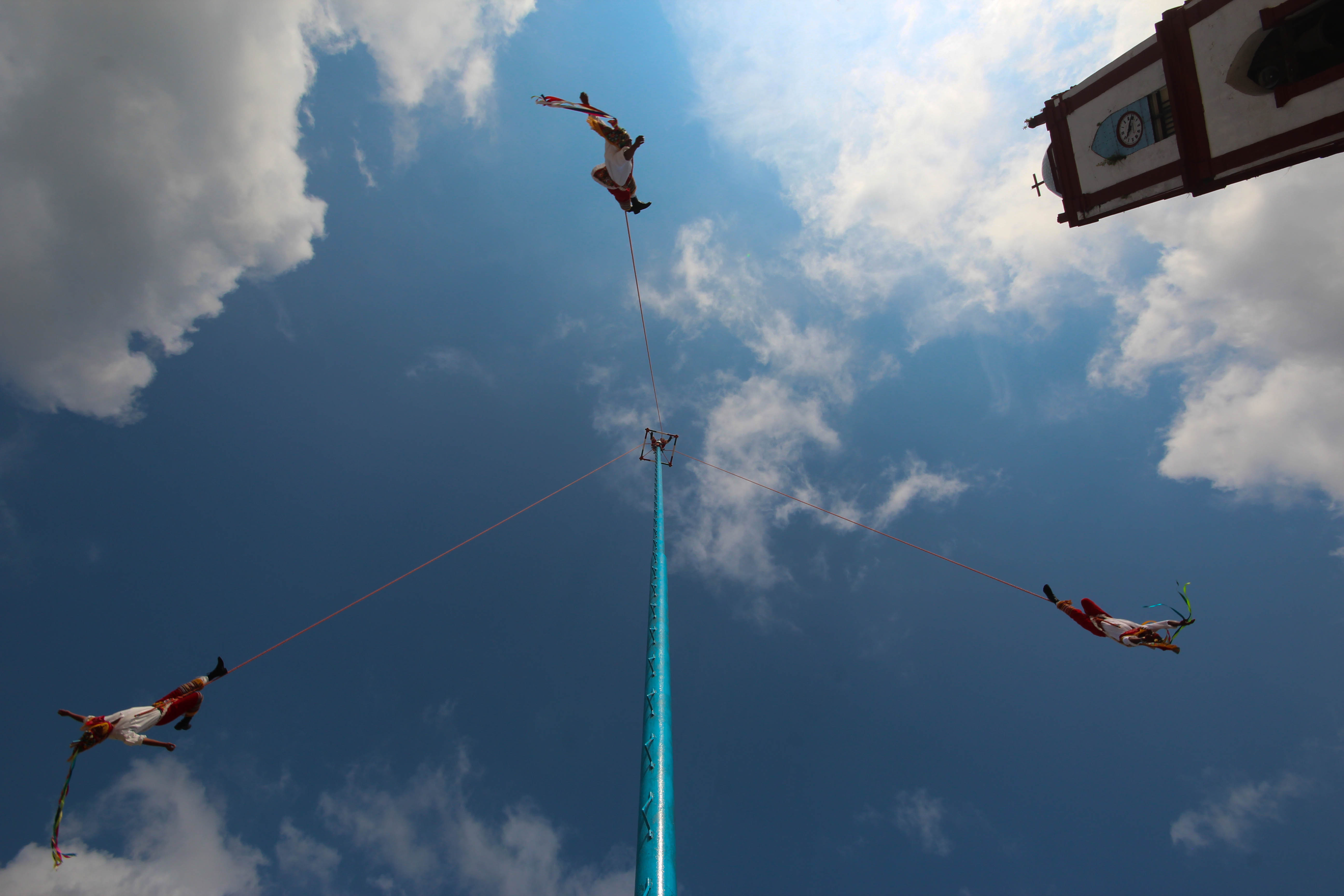 The voladores fly in Papantla's town square. (Photo by Amado Treviño)