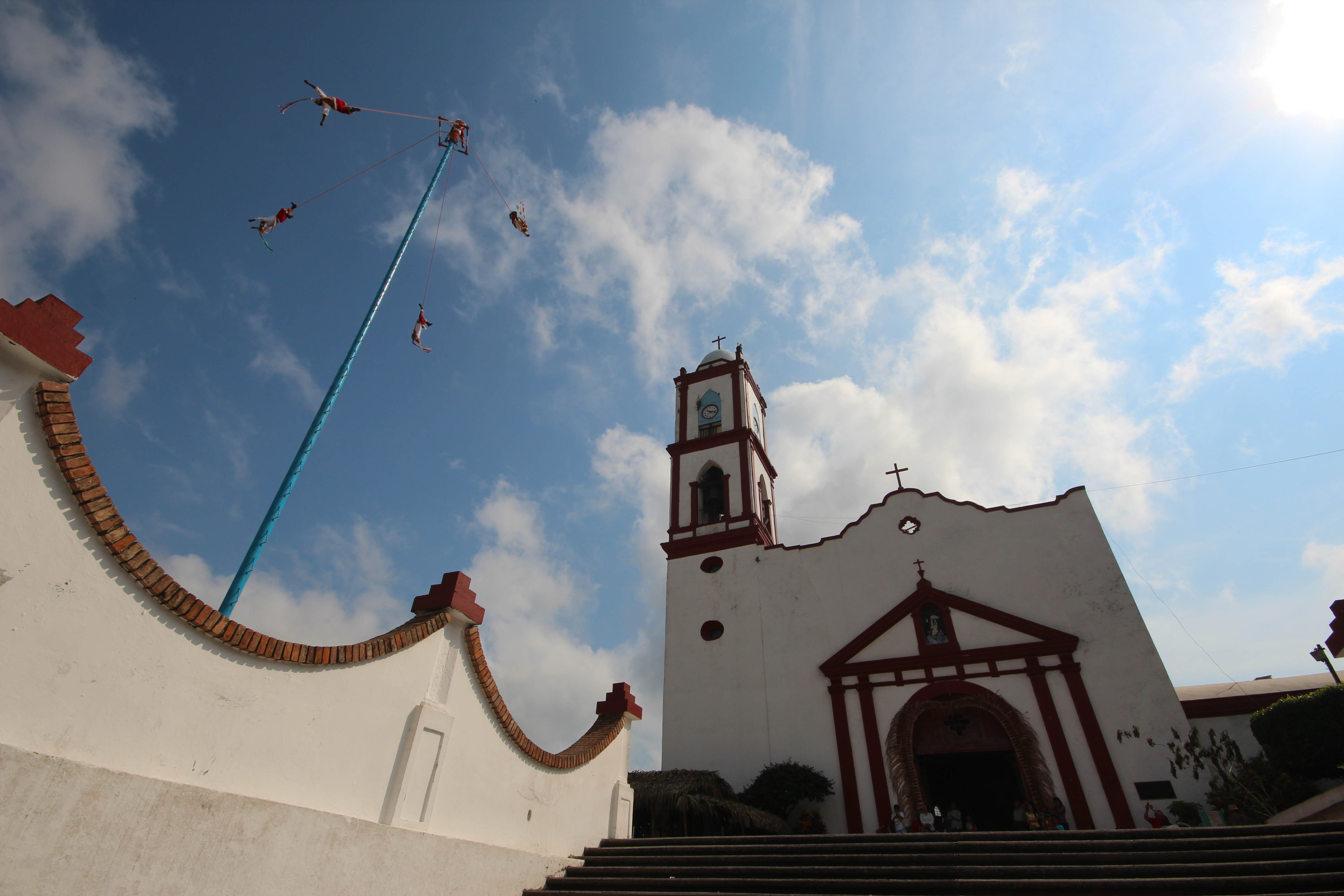 Papantla's main flying pole stands outside a church in the center of town. (Photo by Amado Treviño)