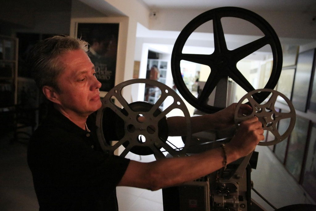 Santiago Cardenas operates one of his beloved projectors. (Photo: Frederick Bernas)