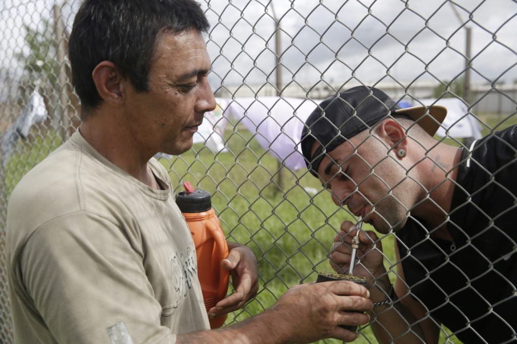Prisoners share a traditional Uruguayan mate. (Photo: Frederick Bernas)